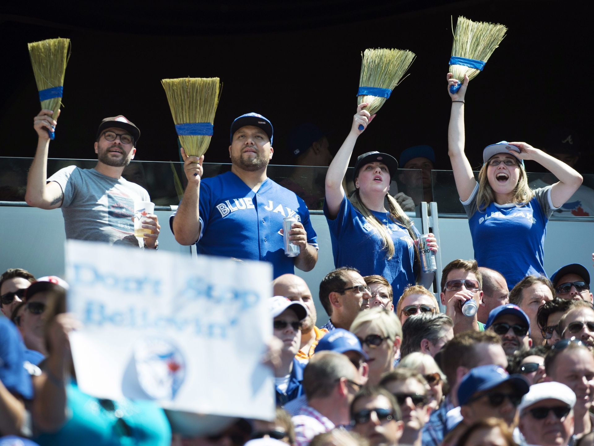 Fans celebrate the Toronto Blue Jays' series sweep of the Oakland Athletics in Toronto.  Darren Calabrese, The Canadian Press via AP