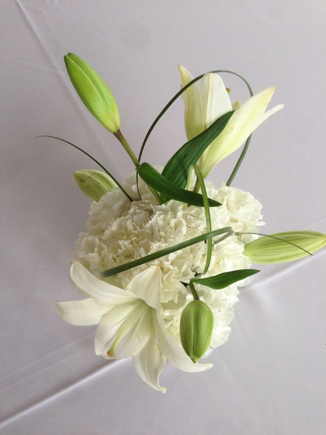 White carnation pave' with white asiatic lilies and bear grass.  By Adorna Design, at TerrAdorna.