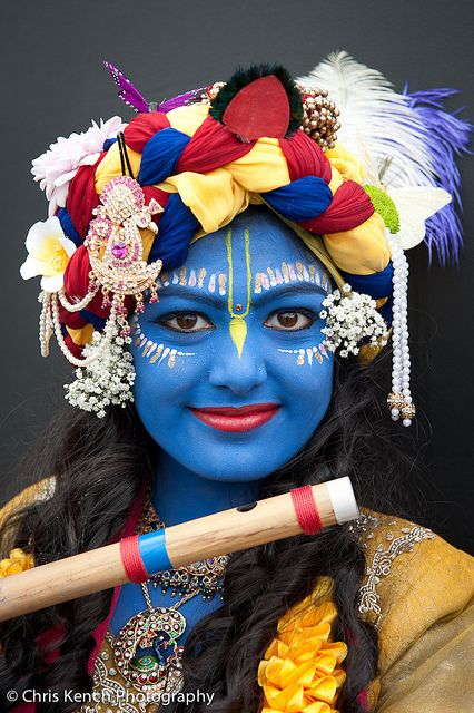 smiling Krishna girl with flute