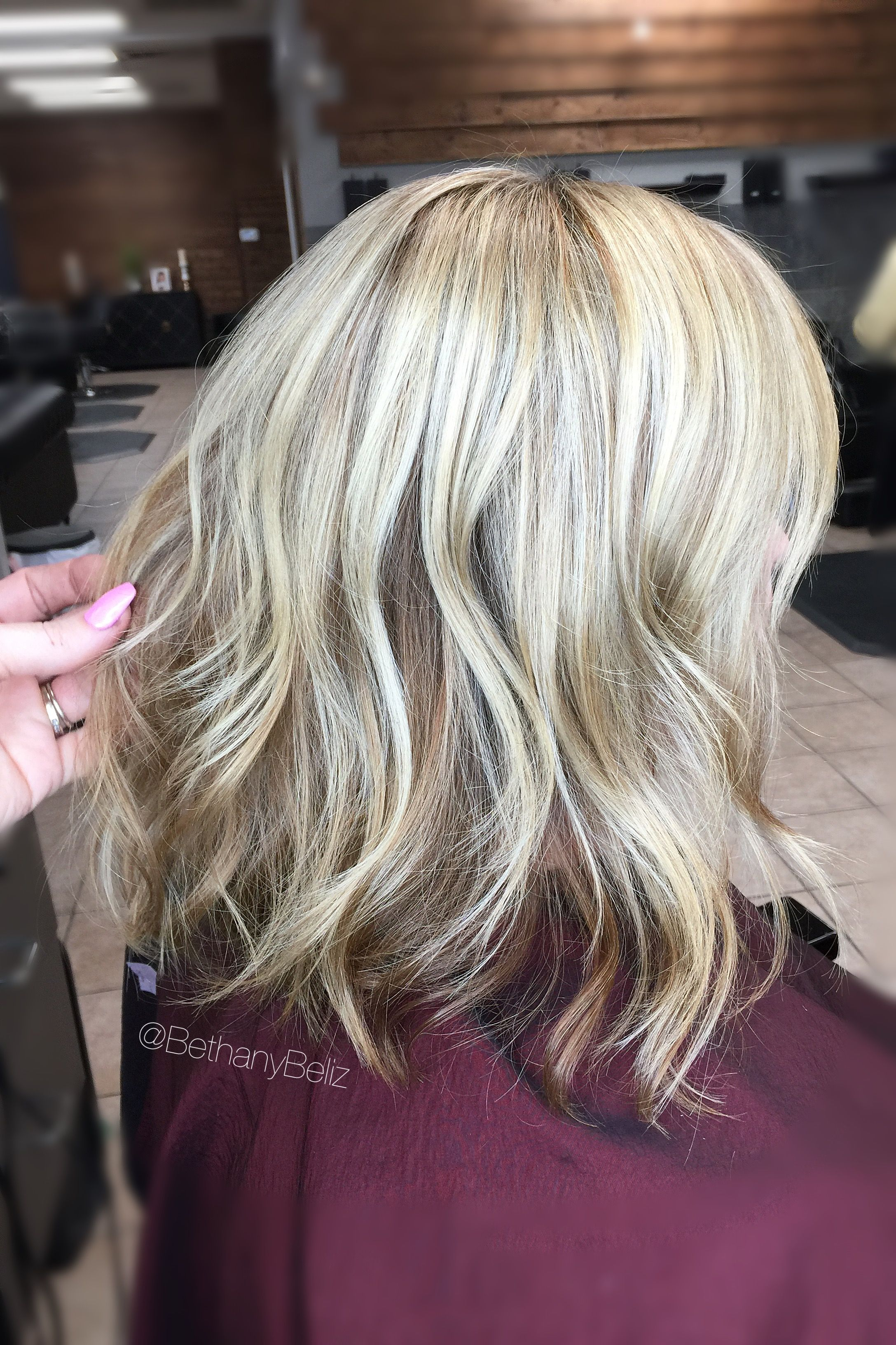 Caramel Color and blonde highlights with a lob Aline haircut