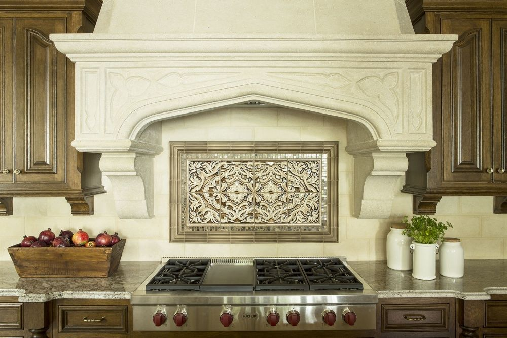 Tudor Arch Range Hood Coordinates With Fireplace In