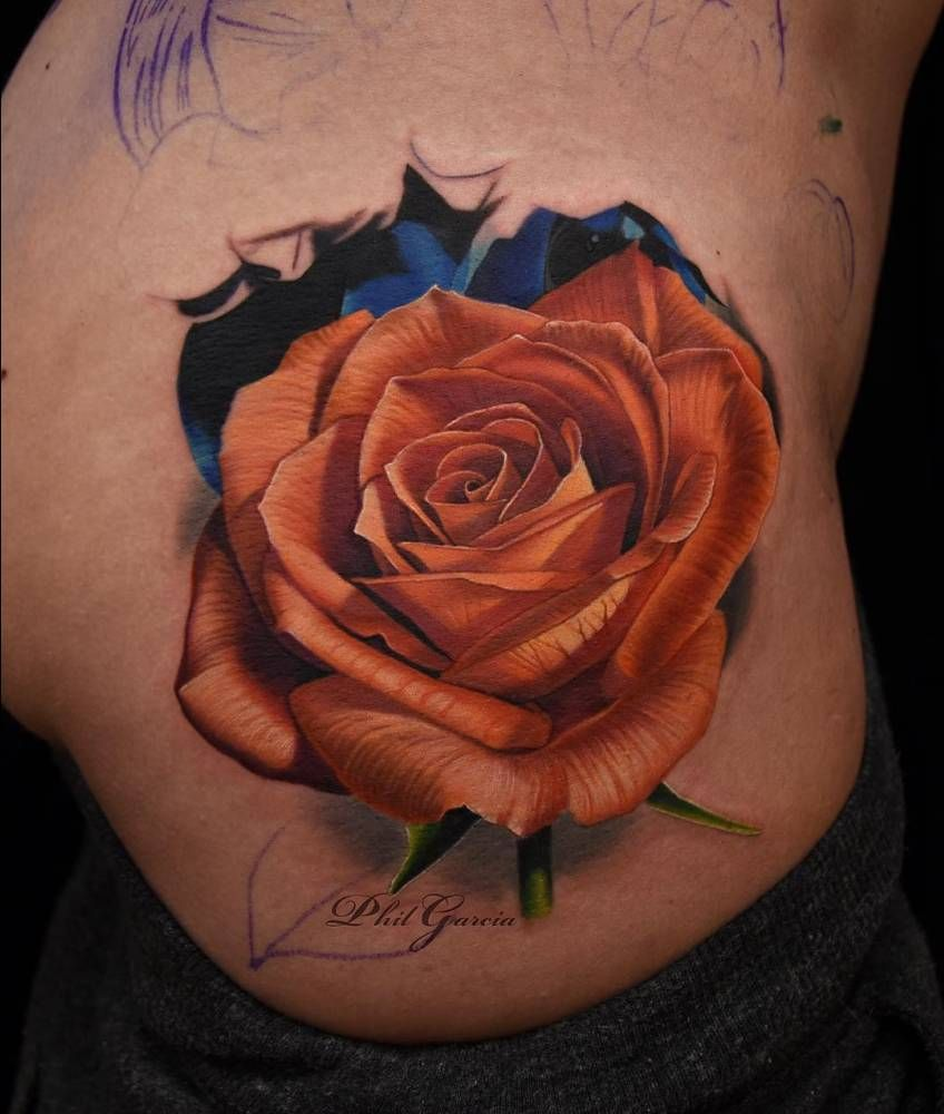 12cc632fa Orange rose tattoo on the right side of the hip. Tattoo Artist: Phil Garcia