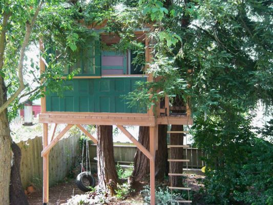 Treehouse Made Out Of Old Windows And Doors