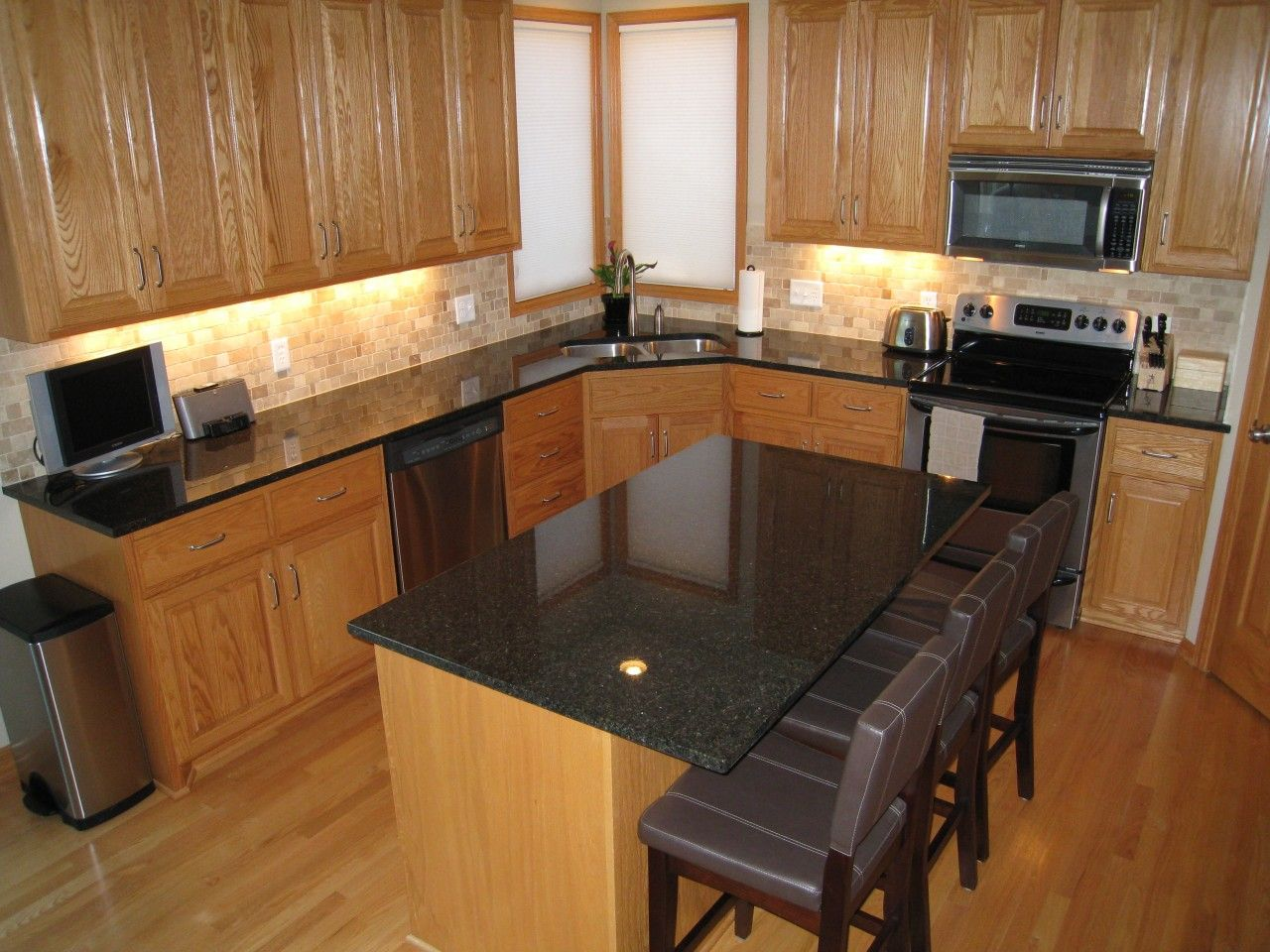 Dark grey countertops with oak cabinets google search for Gray kitchen cabinets with black counter