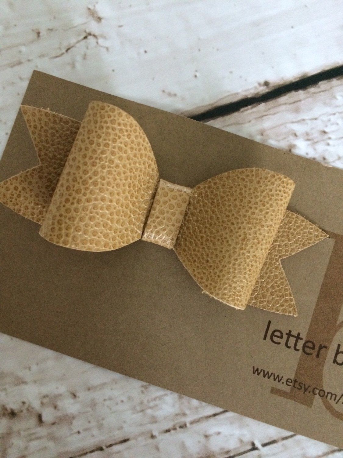 Camel Color Textured Leather Hair Bow on Alligator Clip  by letterbdesigns on Etsy https://www.etsy.com/listing/230446170/camel-color-textured-leather-hair-bow-on