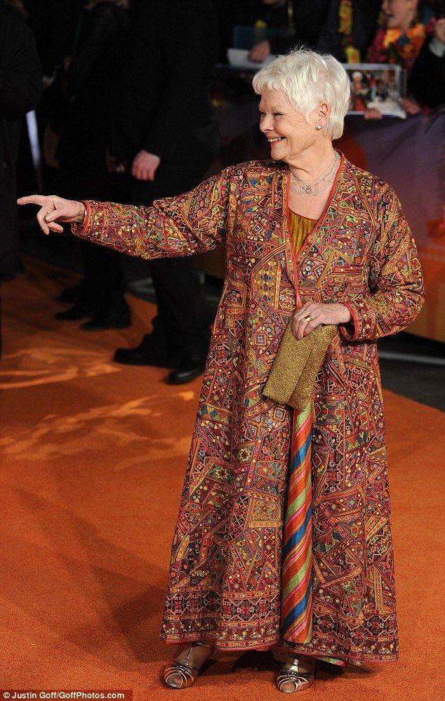 Joking around: Judi was thrilled with the extravagant red carpet set up...
