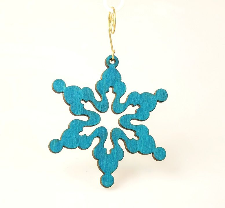 """You unique little snowflake, you! It really is true that no two snowflakes are ever identical.The same is true of handmade items, like this snowflake ornament. It's made in the USA from lightweight, sustainable wood and stained using water-based blue dye.Show everyone on your list that they are one-of-a-kind!Size 3.1"""" x 3.1""""Laser-cut wood"""