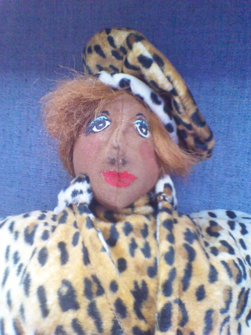 Collectible Doll Dressed in Leopard Fur, $54.99