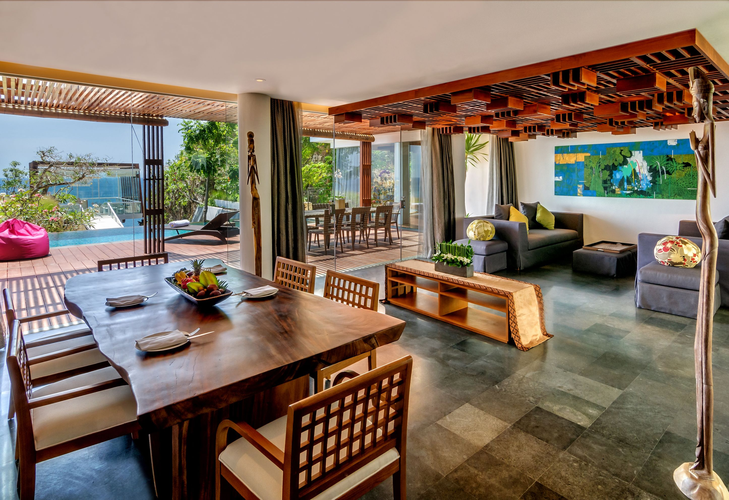 Beach house design. VPool villa dining and living room at