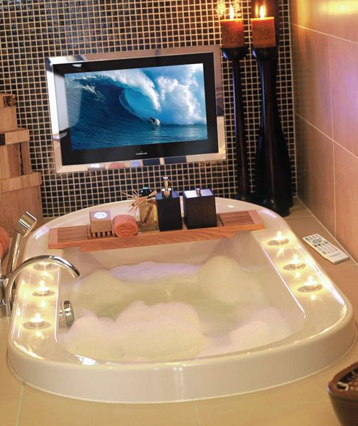 This bath incorporates a waterproof TV!