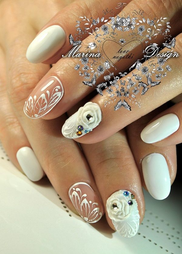 White Nail Art by Marina Design. Instead of painting your nails all white, you can create unique designs with some other elements like the one in the picture above.
