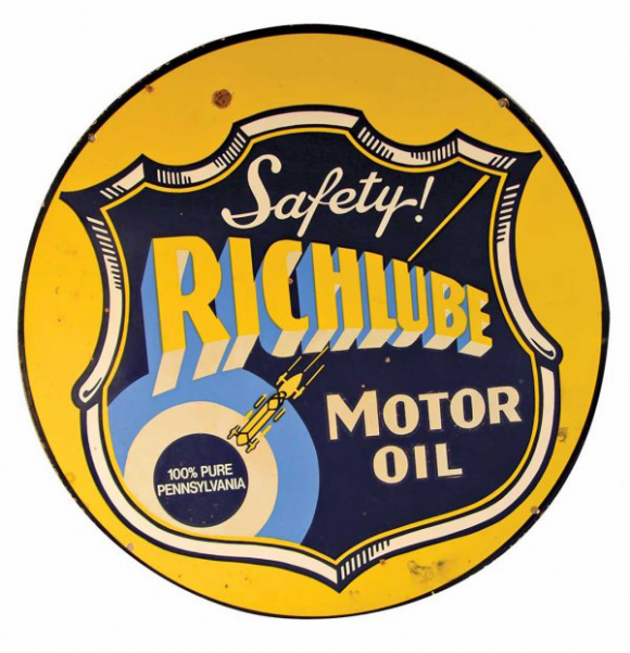 Large round sign for Richlube Motor Oil 100% Pure