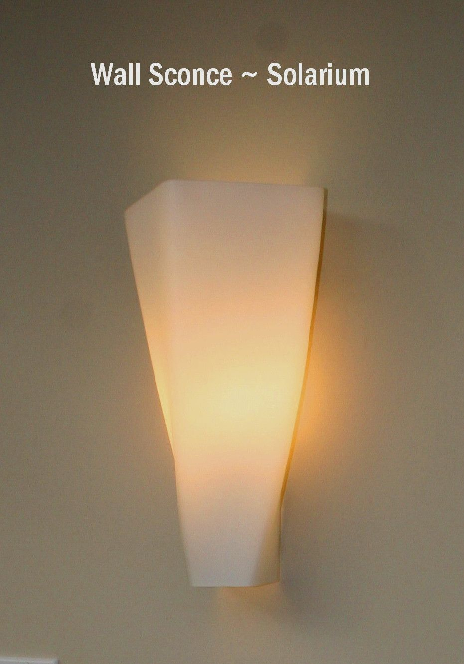 Wall sconce light fixture with an \'organic\' look giving a soft ...