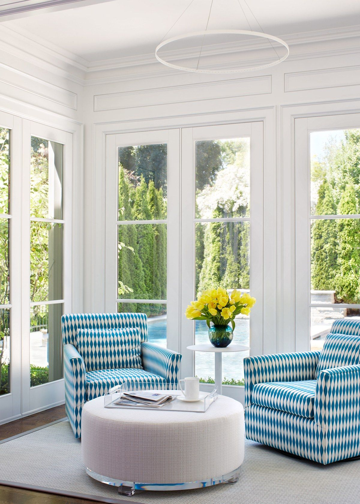 In the sunroom, turquoise-and-white swivel chairs from Jonathan ...