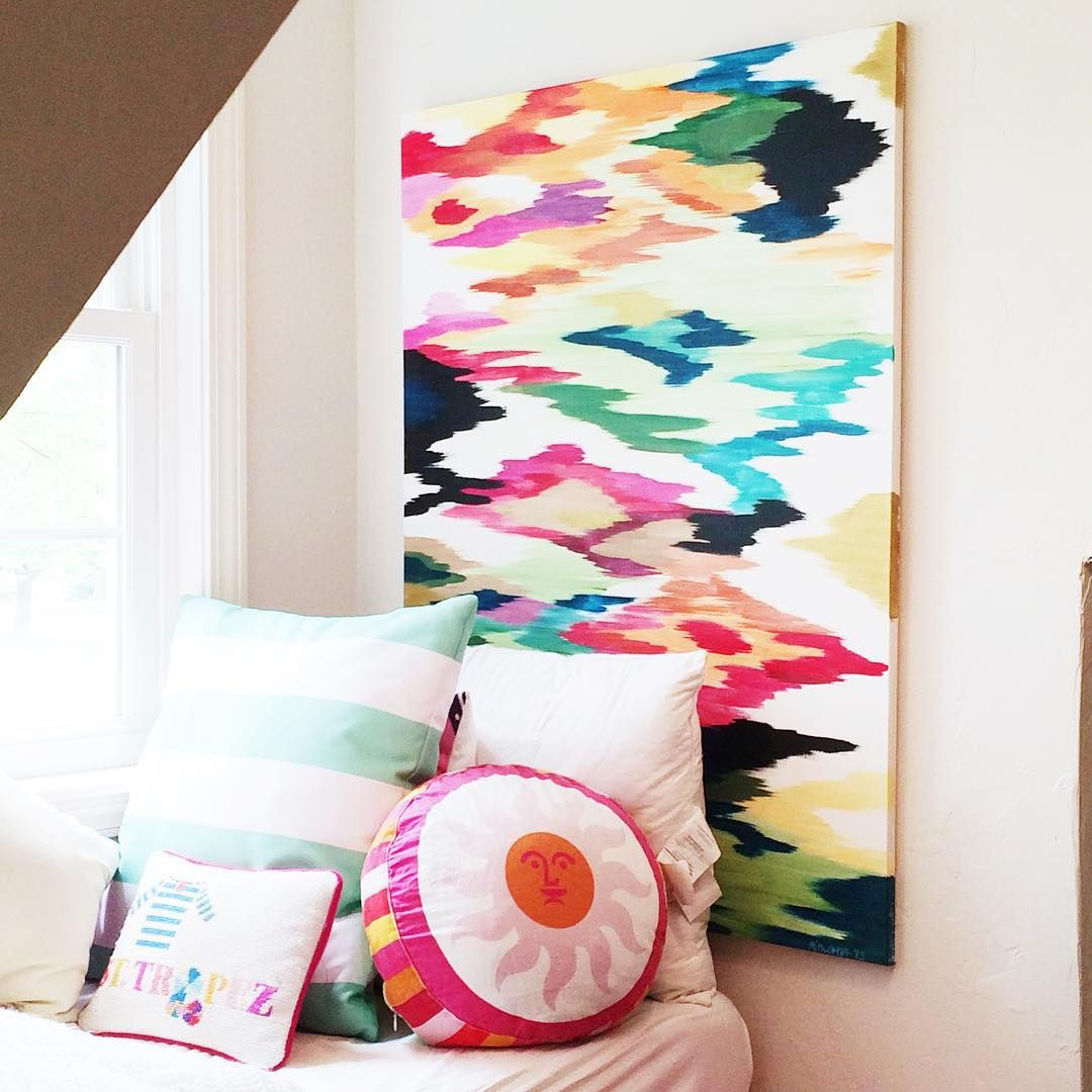 Window seat with colorful Rita Ortloff painting http://instagram.com/pencilshavings