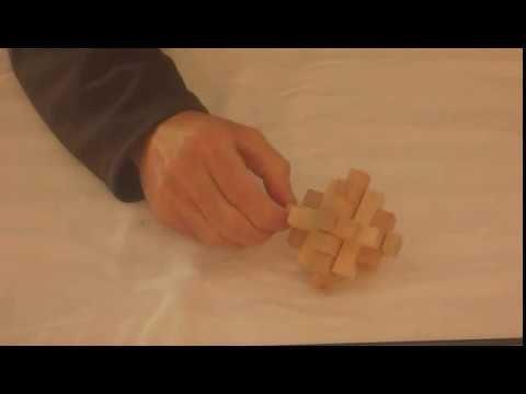 wooden Newton's Comet puzzle - 15 piece | puzzle solutions | Puzzle