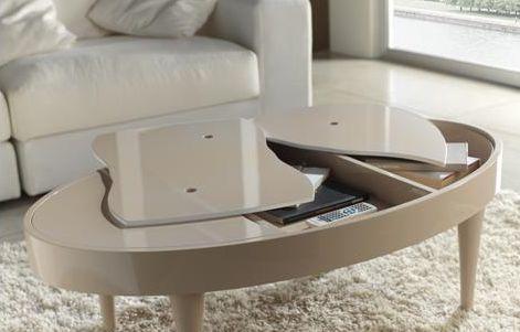 Mesa de centro 120 x 70 cm. tapas con sistema original de apertura y patas cónicas.