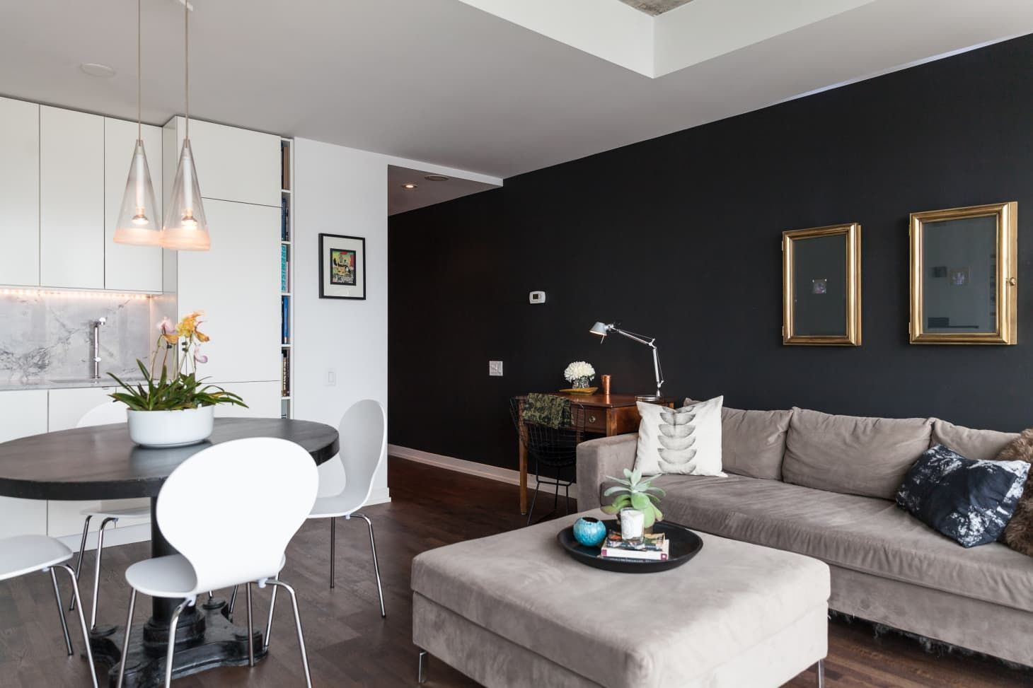 Black Walls Instant Grown Up Home Here S How To Make Them Work Black Walls Living Room Black Accent Wall Living Room Stone Wall Living Room