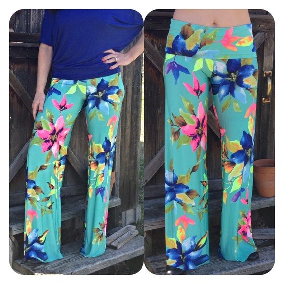 Last pair size small 0-7 New arrival just in time for that vac.. These floral print palazzo pants are amazing. In turquoise.  Sm 0-7  Inseam approx 34.         Two small Pants