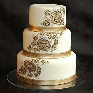 Bands of fondant painted with gold luster dust (mixed with a few drops of liquid) emphasize the chocolate-piped floral design lightly filled in with more gold luster dust.
