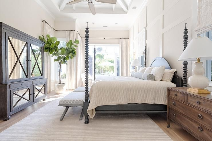 Unwind In A Cozy, Serene Cottage Bedroom Such As This Completed With A  Black Spindle 4 Poster Bed Dressed In A White Textured Duvet And Finished  With White ...