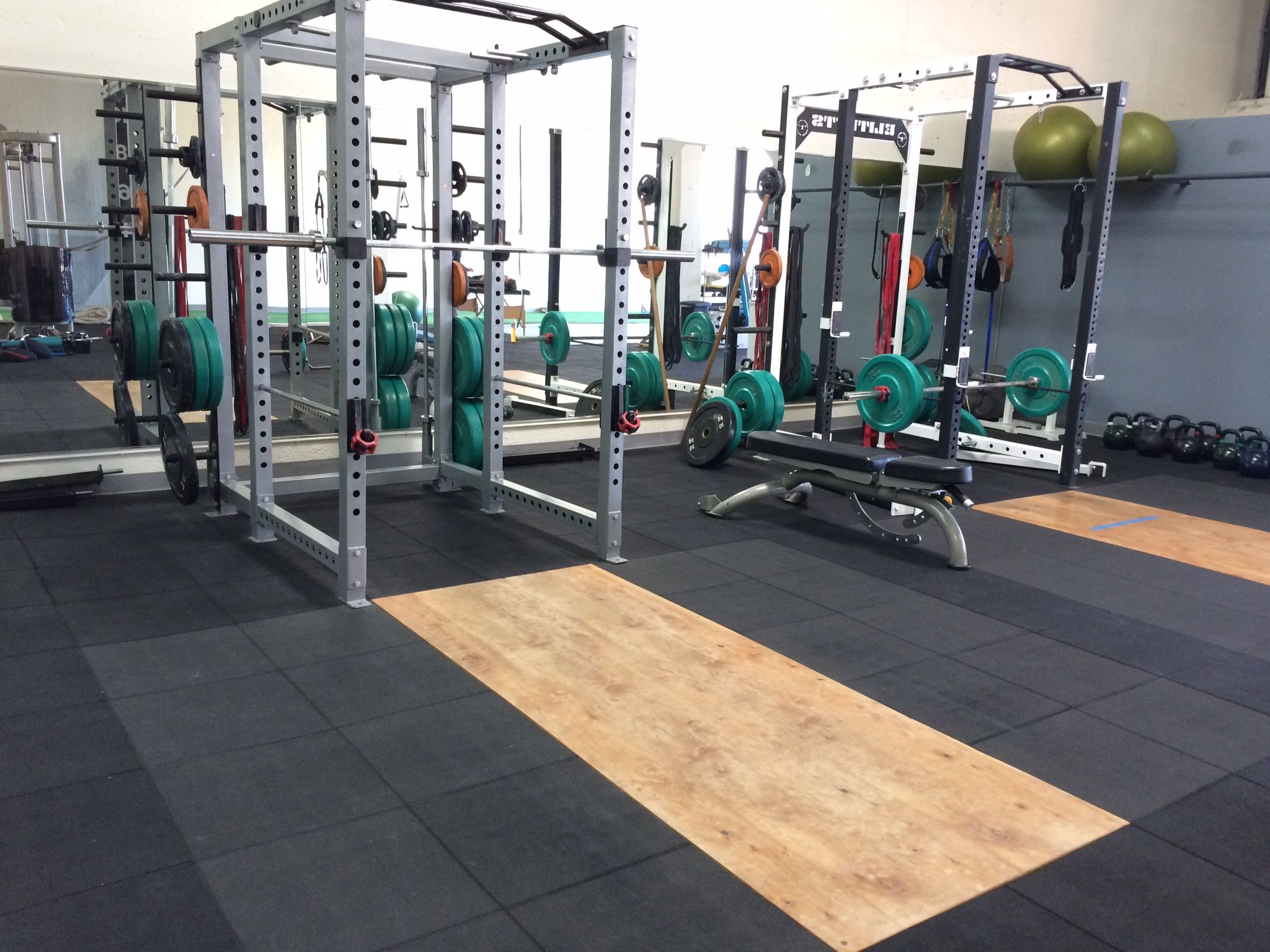Olympic weight lifting platform with full size squat rack