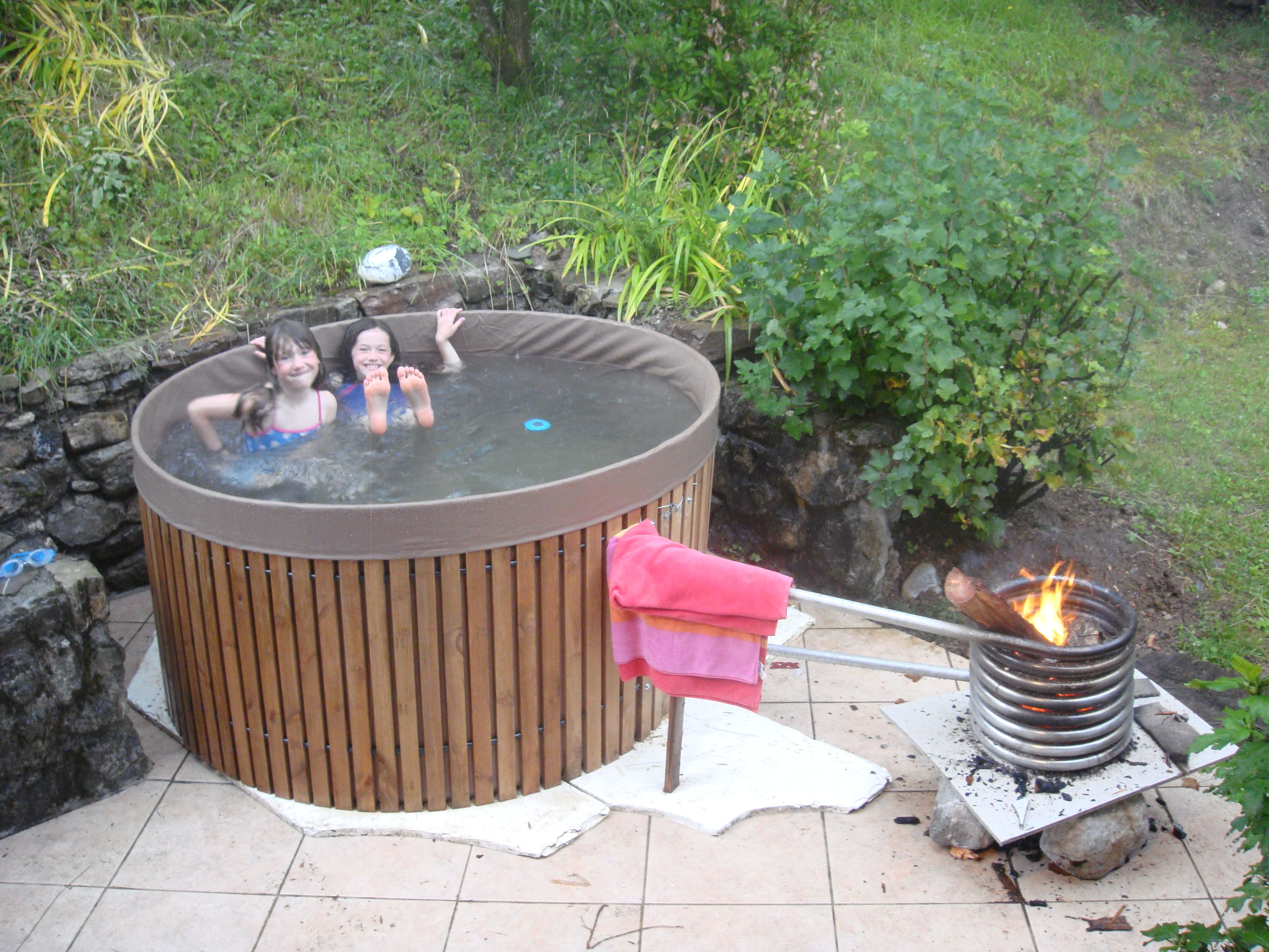 Cheap diy hot tub jacuzzi 4 - Diy Hottub Bath Temp Degrees In 4 Hours Just A Wood Fire Inside Pipe Spiral Hot Water Rises And Draws In Cooler Water From Below Making Thermal