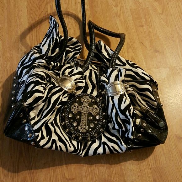 Zebra purse Very cute zebra purse with crystal cross, spot on inside can probably be cleaned Bags