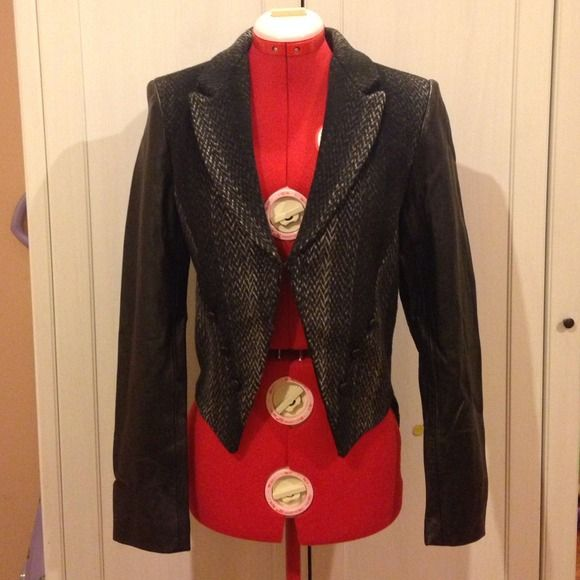 American Retro tuxedo jacket Top off your look in this amazing jacket. Wool and leather combination, tuxedo cut, hook closure. Very flattering style. New with tags. Retails for over $200.(89) American Retro Jackets & Coats