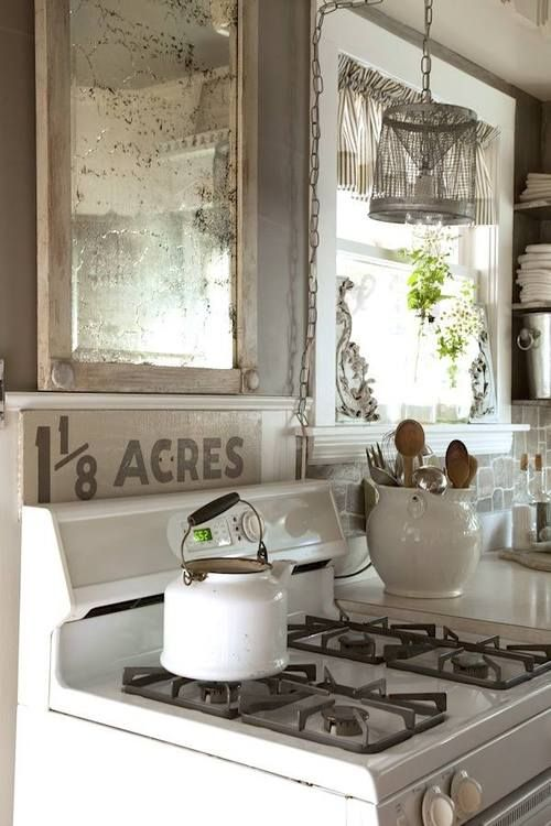 Inspiring & Dreamy-mirror in kitchen....could open up a smaller kitchen and make it look bigger.