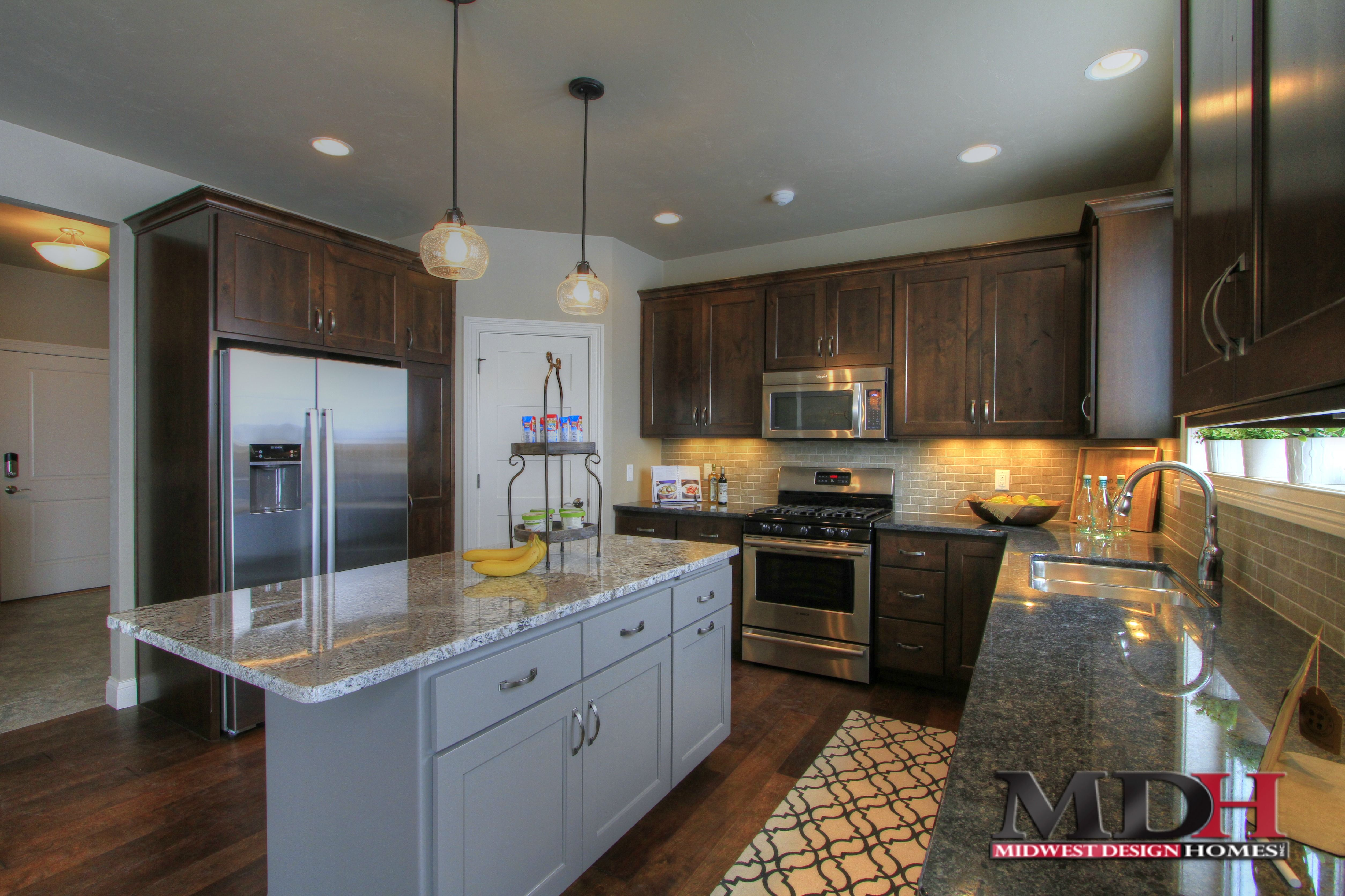 Dark stained maple cabinets in custom kitchen with grey ... on Gray Countertops With Maple Cabinets  id=11155