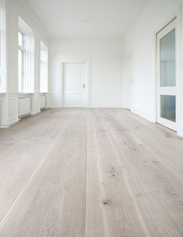 Amazing space  white walls  whitewashed wood floors.   WHITE :)