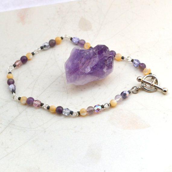 Sophia Amethyst & Mother-of-Pearl Bracelet; AURAGEMSbyHeather  Named for the goddess of wisdom, Sophia, this bracelet is made with amethyst for spiritual awareness and mother-of-pearl for wisdom.