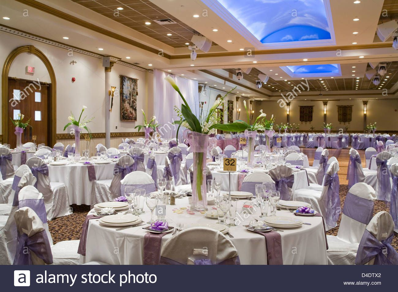 Indoor Wedding Reception Hall With Round Tables And Flower