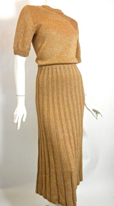 1930s bronze metallic knit dress with deco sunburst neckline and ribbed skirt.