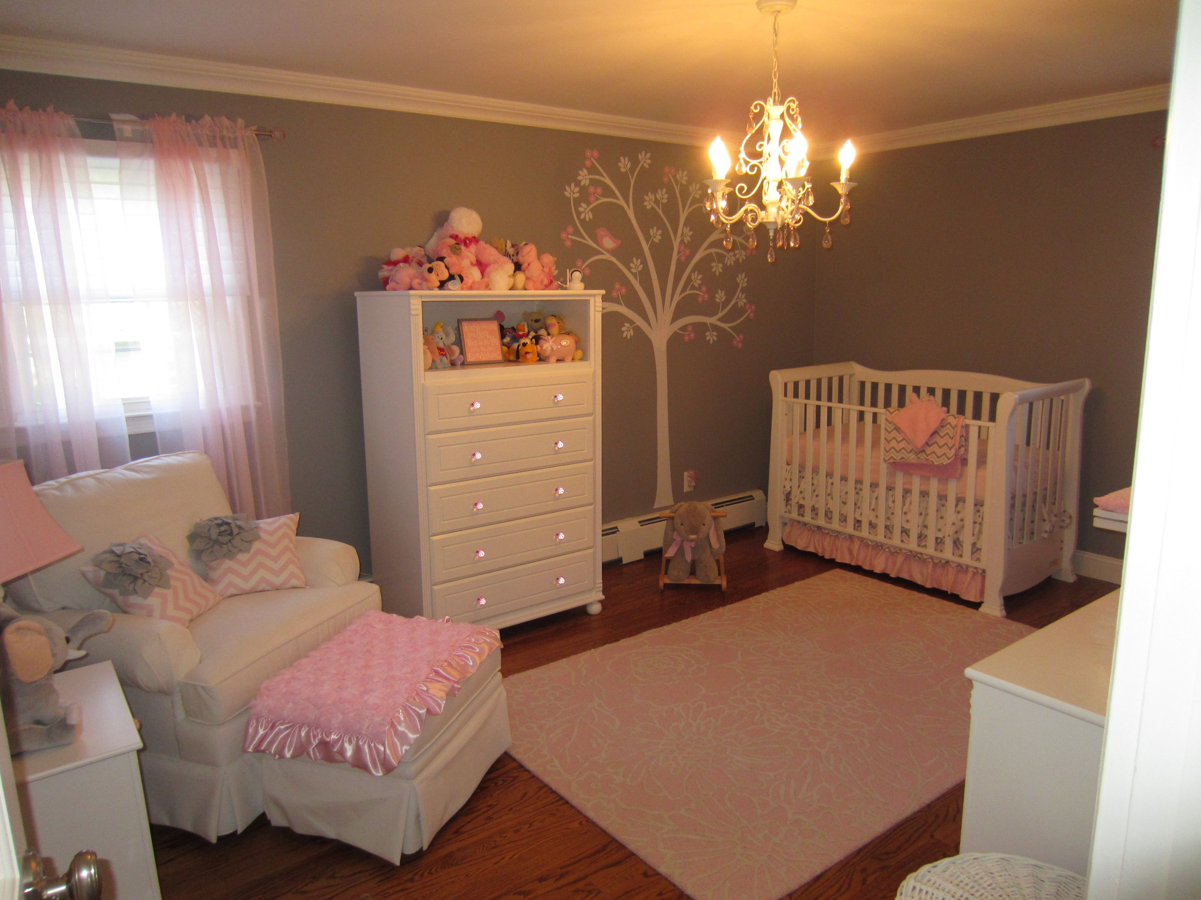 Soft pink and gray painted walls, ceiling, and floral tree