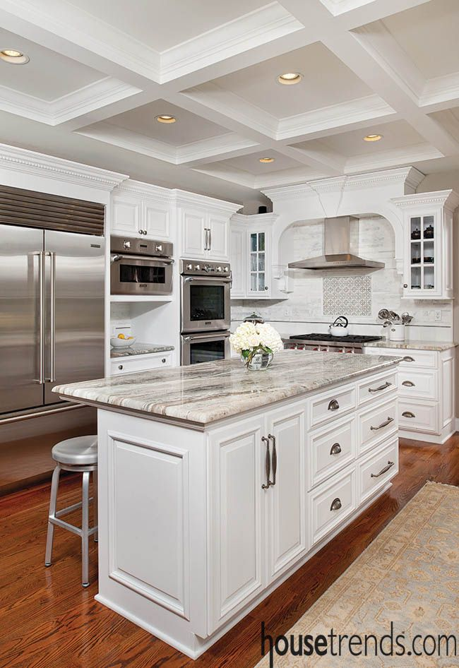 Granite countertops and white cabinets in this