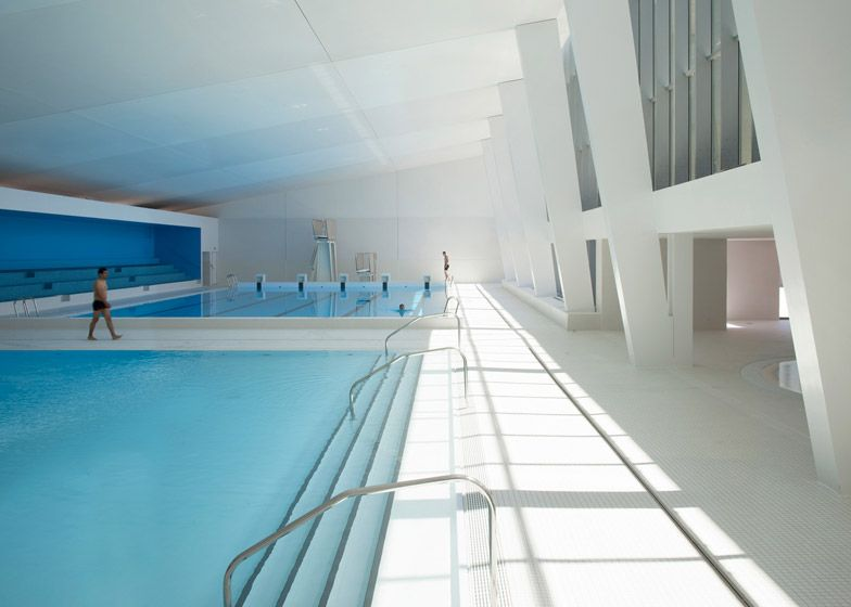 Paris swimming pool refurbishment features blue bleachers ...
