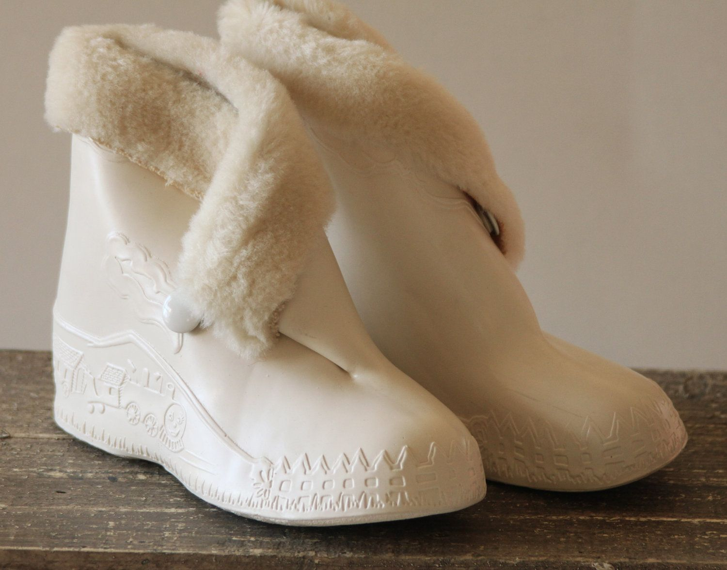Girl's vintage 1950's rubber snow boots. The pulling and stamping ...