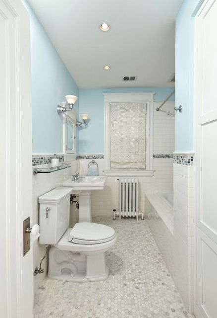 Clean White Grey Bathroom With Tile Border That Goes Through The