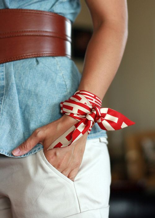 A red and white silk Hermes Twilly tied as a bracelet.   Family ... 707a061566e