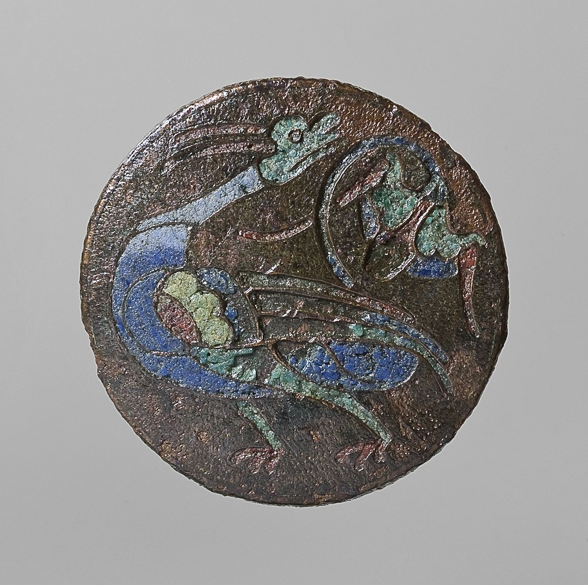 Brooch with a bird and a flower. Roman, 200-400  Bronze, enamel