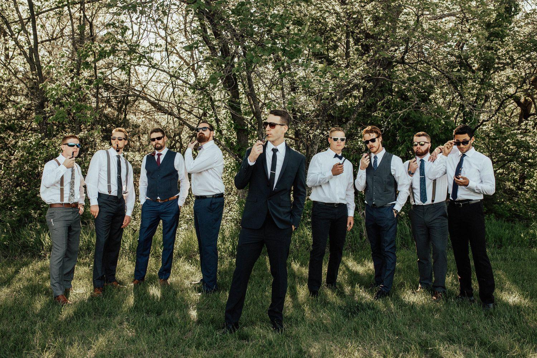 groomsmen poses bohemian chic backyard wedding in lawrence ks