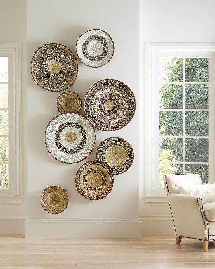 A favorite decorating trend of 2020 is woven home decor like rattan and cane furniture & accessories! #wallart #baskets