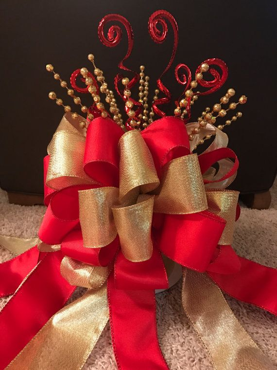 large christmas tree bow topper red gold made with 25 wired ribbon and decorative picks contains 32 loops of ribbon and 8 2ft long streamers