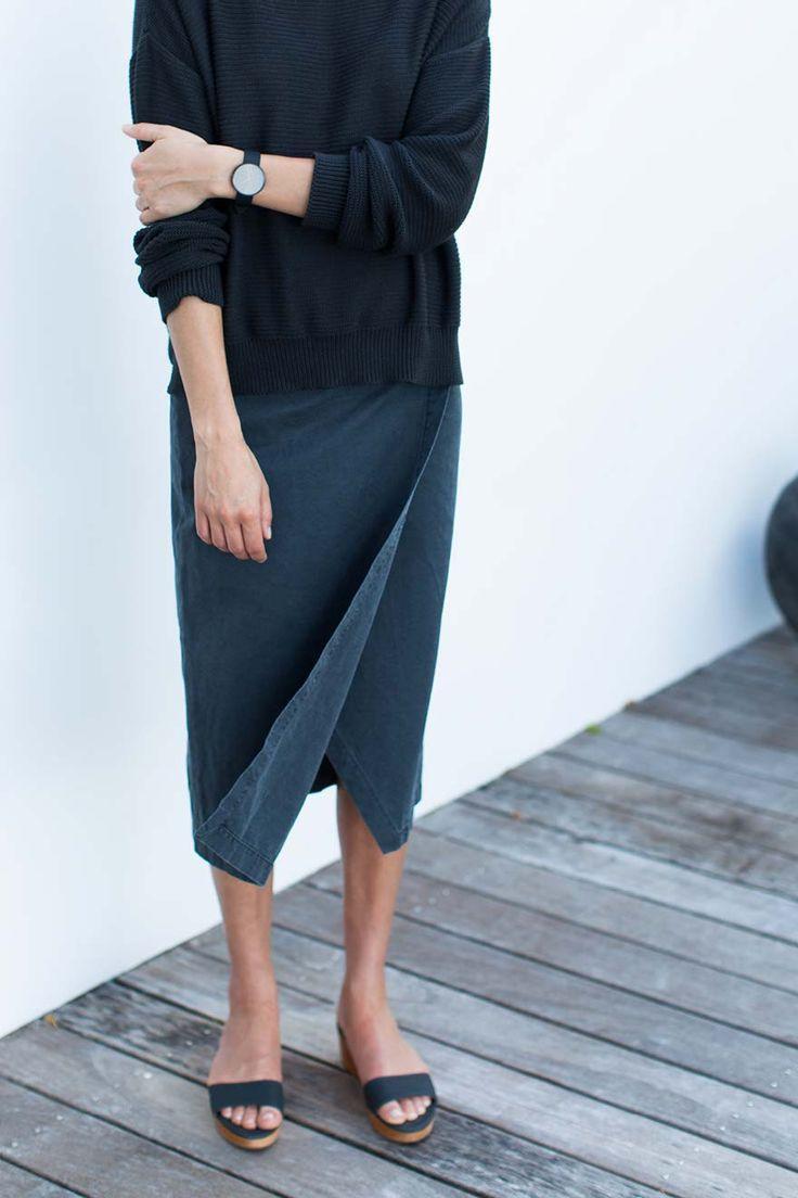 Plain navy jumper. Denim wrap skirt, dark blue.