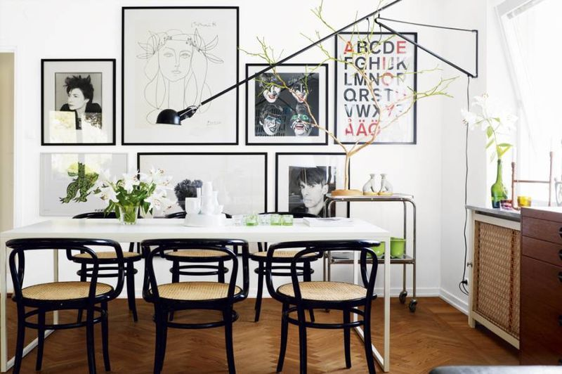Love the simple classic lines in this dining room the elegant thin black frames on the art really tie the wall and room together