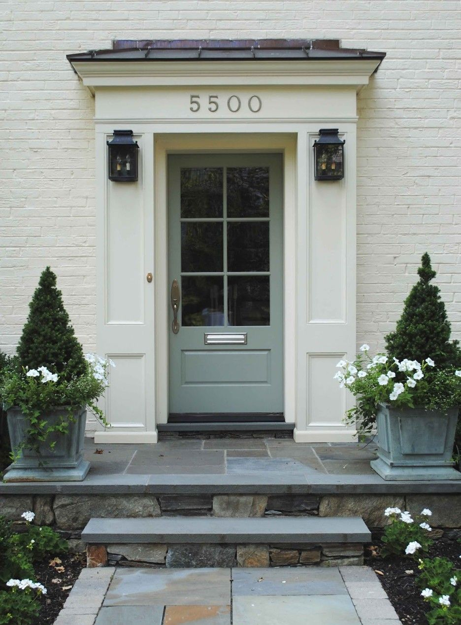 Exterior Decorative Green Potted Plants Closed To Vintage Glass Front Door Of White Brick House