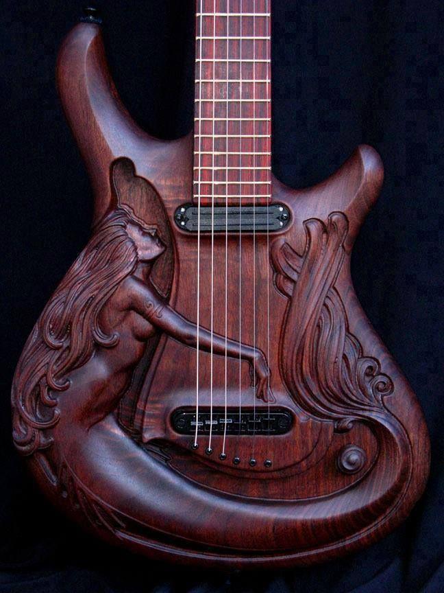 Art nouveau, wood, and a guitar!