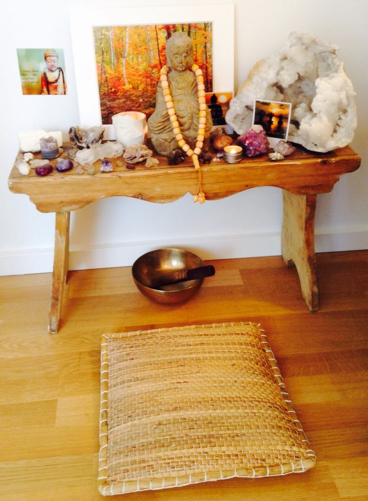 My meditation area with a Buddha and crystals